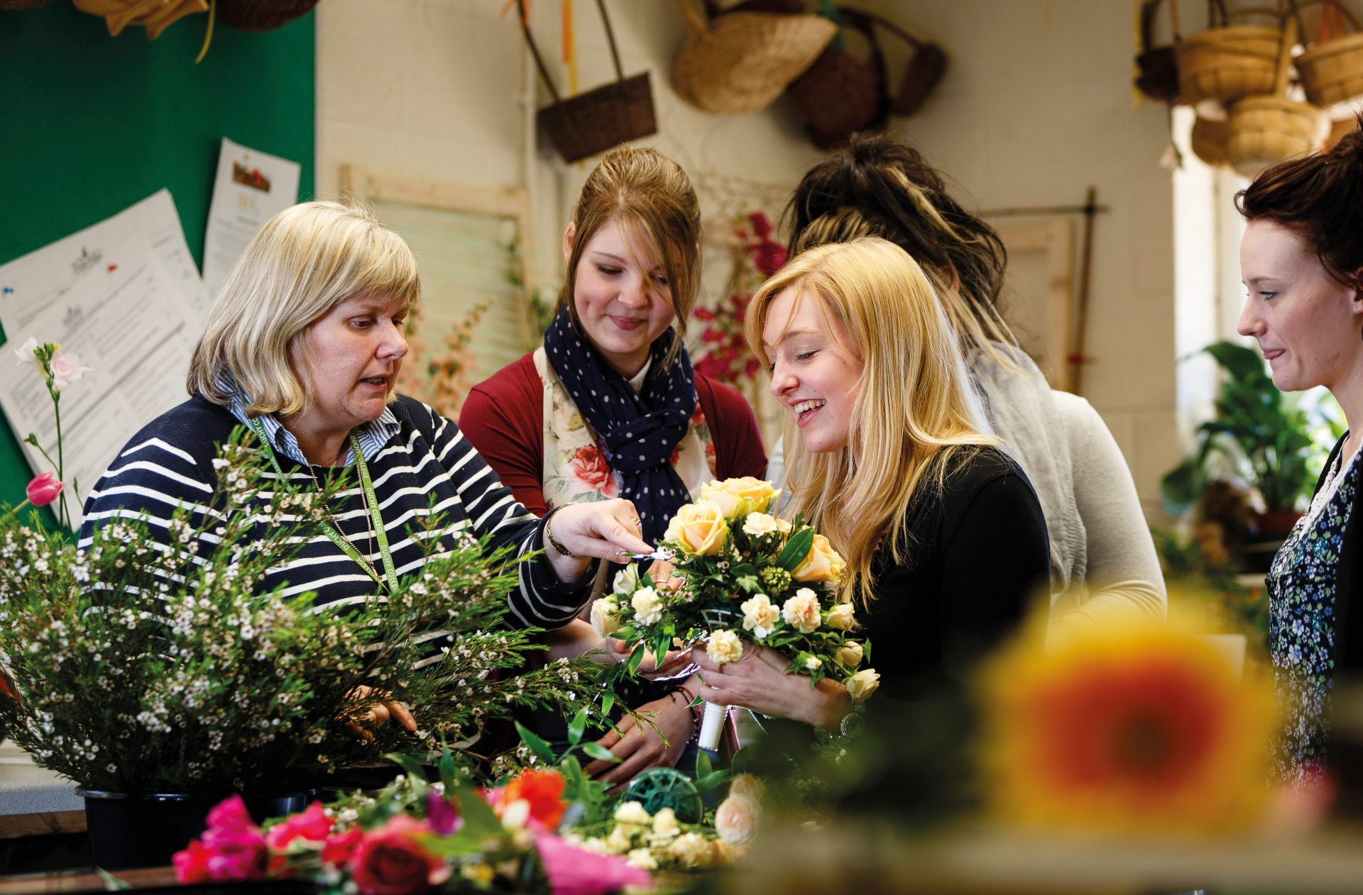 Floristry students receive a lecture on different types of plant from their tutor