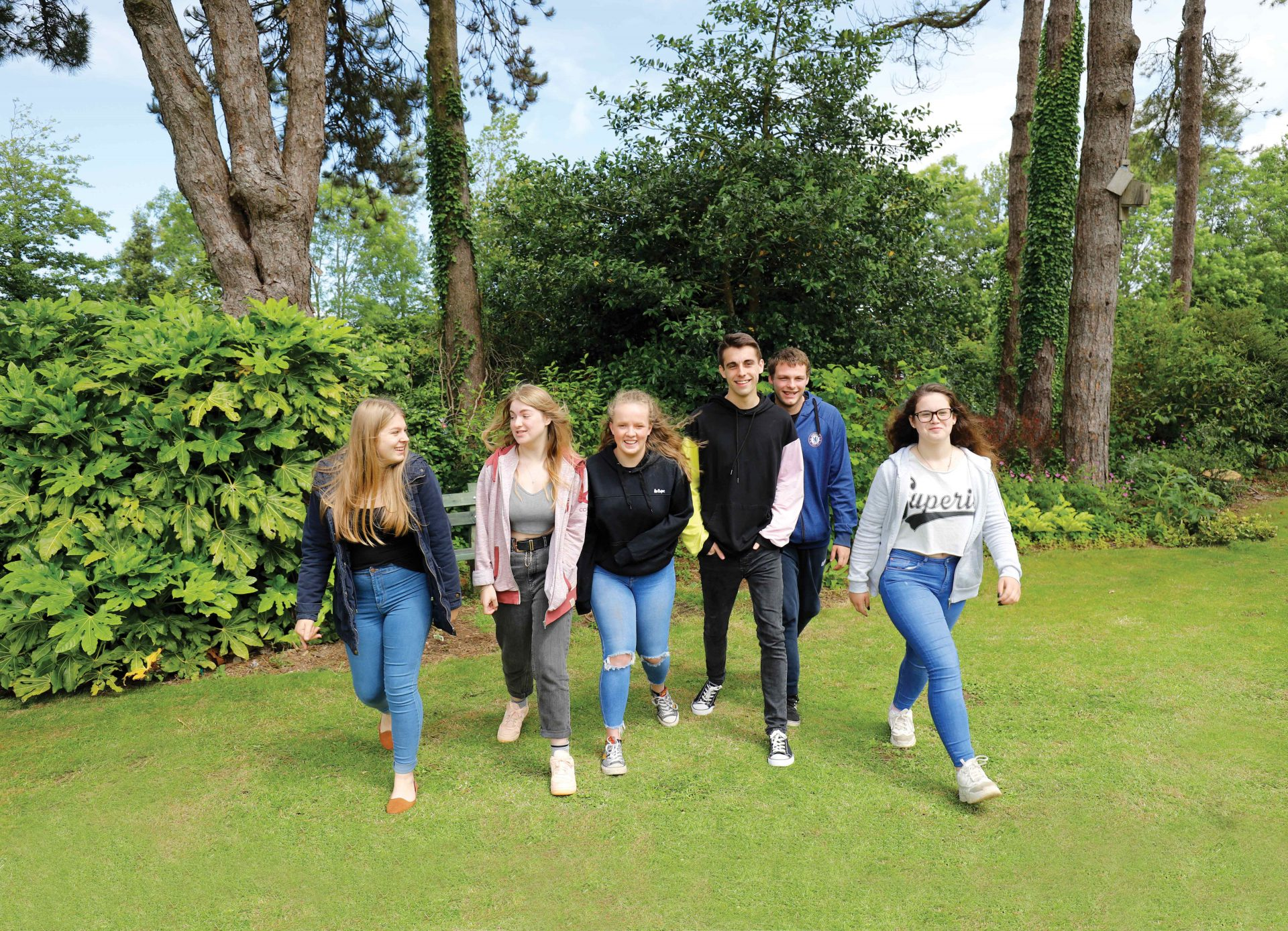 Students smiling as they walk towards the camera at Duchy College